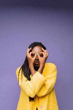 Beautiful ethnic model gesturing on purple background