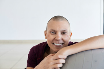 Portrait of cheerful woman fighting cancer.