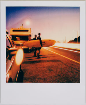 Two California Surfers With Longboards on Vintage Night Polaroid