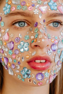 Closeup beauty portrait of face covered with crystals