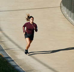 Athlete running in urban outdoors to maintain a healthy lifestyle.