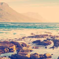 Coastal Rocks and Mountains
