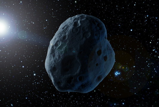 A huge asteroid in space, on a dark background.  Elements of this image were furnished by NASA
