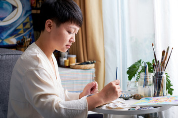 Asian woman painter, art painter. Work at home