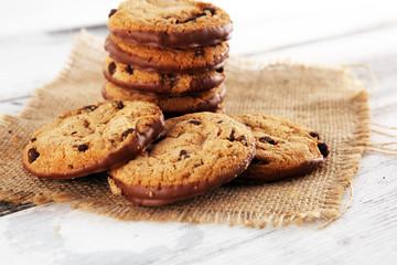 Fotobehang Koekjes Chocolate cookies on wooden table. Chocolate chip cookies shot on wooden white table