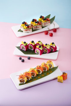 Exquisite Japanese cuisine sushi platter, arranged in a pink background