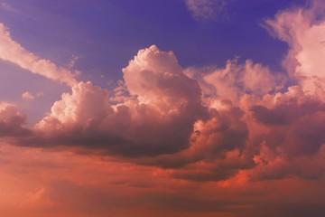 Fototapeta Beautiful shot of large clouds in the beautiful orange sky at sunset obraz