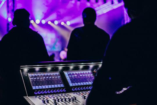 Remote concert sound engineer watching a rock concert.