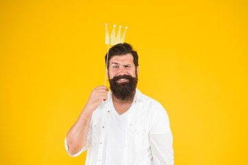Handsome bearded guy king. Guy in yellow background posing with booth props. Photo booth fun. Bearded man king costume party. King of party. Costume party. Holiday carnival celebration. Birthday boy Fototapete