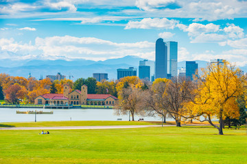 Scenic of Denver Colorado skyline. City Park, Ferril Lake and Rocky Mountains. Located in Denver, Colorado, USA.