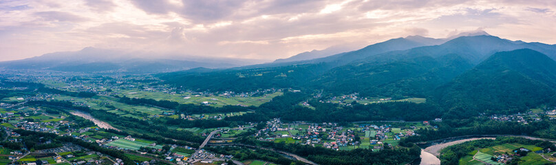 Aerial drone photo - The beautiful mountainous countryside of Japan.  The many rice fields, mountains, and villages of Gunma Prefecture.