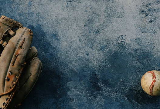 Grunge baseball background with ball and glove.