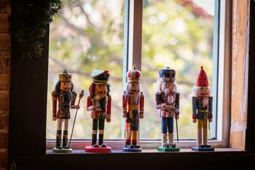 Nutcracker dolls in window.