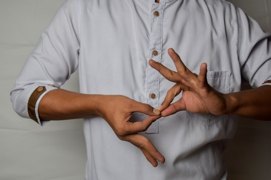 Close up Asian man shows hand gestures it means interpreter appreciation isolated on white background. American sign language