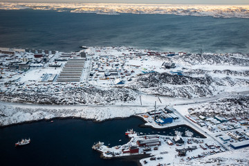 Aerial view to the fjord, port and snow streets of Greenlandic capital Nuuk city, Greenland