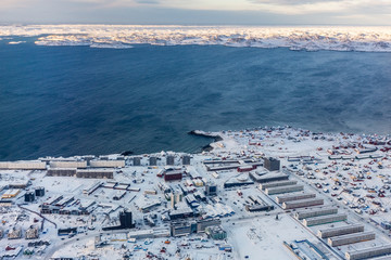 Aerial view to the fjord and snow streets of Greenlandic capital Nuuk city, Greenland