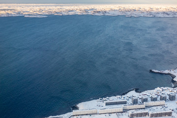 Aerial view to the fjord, Inuit houses and snow street of Greenlandic capital Nuuk city, Greenland