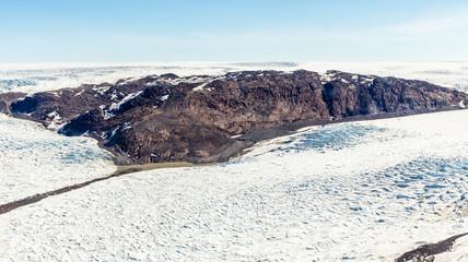 Greenlandic melting ice sheet glacier aerial view from the plane, near Kangerlussuaq, Greenland