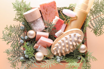 Christmas composition products for spa treatment on color background
