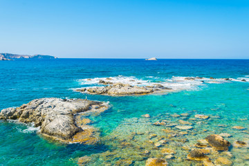 A rocky beach with turquoise crystal clear waters near Mandrakia village in Greece