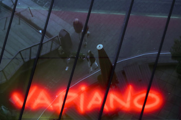 Pedestrians are reflected in a window of a restaurant of the German franchise company Vapiano in Munich