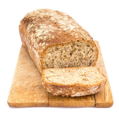 In de dag Brood Homemade loaf of bread on plank isolated on white background