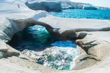 Sarakiniko beach with the greyish white volcanic rocks in Milos island, Greece