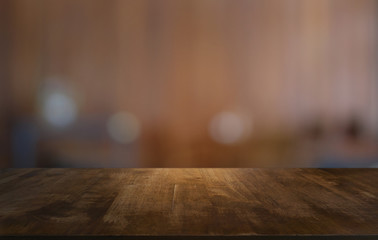 Empty dark wooden table in front of abstract blurred bokeh background of restaurant . can be used for display or montage your products.Mock up for space.
