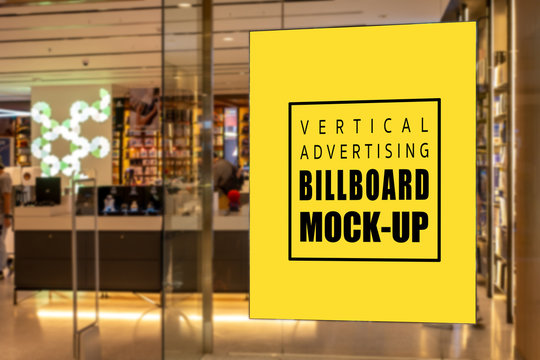 Mock up vertical signboard on glass panel of record store