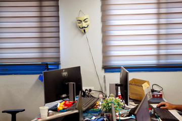 """A Guy Fawkes mask made popular by the movie """"V for Vendetta"""", hangs on a wall in an office at Cybergym, a cyber-warfare training facility backed by the Israel Electric Corporation, in Hadera, Israel"""