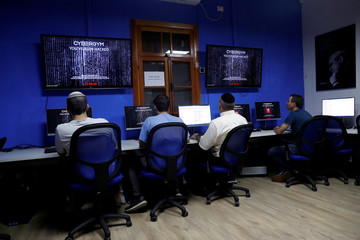 People take part in a training session at Cybergym, a cyber-warfare training facility backed by the Israel Electric Corporation, at their training center in Hadera, Israel