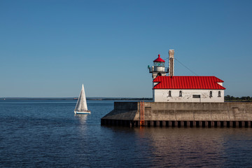 Lake Superior Lighthouse with a Sailboat