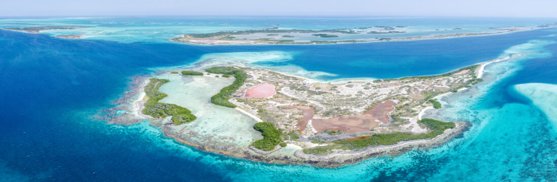 Caribbean: Vacation in the blue sea and deserted islands. Aerial view of a blue sea with crystal water. Great landscape. Beach scene. Aerial View Island Landscape Los Roques