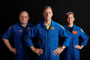 Boeing astronaut Chris Ferguson poses for a picture with NASA commercial crew astronauts and Star Liner members Nicole Mann and Mike Fincke at the Johnson Space Center in Houston
