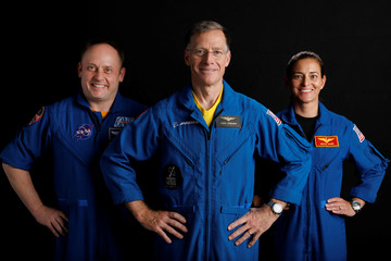 Boeing astronaut Chris Ferguson poses for a picture with NASA commercial crew astronauts and Starliner members Nicole Mann and Mike Fincke at the Johnson Space Center in Houston