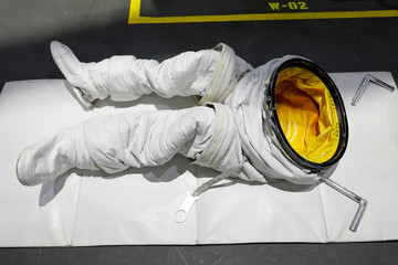 The space suit pants of the NASA Commercial Crew Astronaut Josh Cassada are seen on a pool desk awaiting his arrival at NASA's Neutral Buoyancy Laboratory (NBL) training facility near the Johnson Space Center in Hou