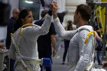 NASA Commercial Crew astronaut SunitaWilliams high-fives fellow astronaut Josh Cassada before being fitted into the space suits at the start of training at NASA's Neutral Buoyancy Laboratory (NBL) facility near the Johnson Space Center in Houston