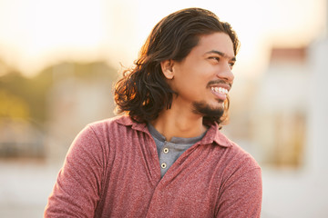 Long hair indian young man portrait.