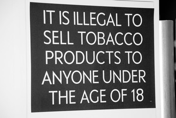A tobacco products age restriction sign at a UK store.