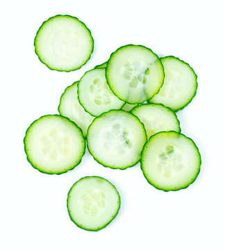 cut cucumbers isolated on white