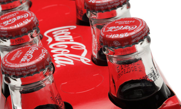 Chartres,France- October 6th, 2011: Close-up of upper part of traditional bottles of Coca Cola in a paper pack.