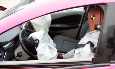 A crash test dummy is seen in the driver's seat of a Renault Zoe electric car after a controlled crash test from insurer AXA in Duebendorf