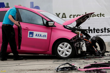 A Renault Zoe electric car is seen after collision with an oncoming Volvo V70 car in a controlled crash test from insurer AXA in Duebendorf