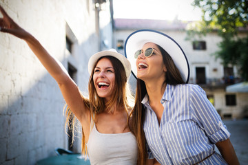 Girl friends travelling summer vacation exploring to discover carefree lifestyle