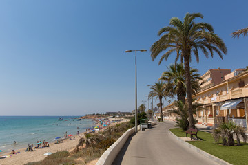 Mil Palmeras Costa Blanca Spain with palm trees and apartments and beach in beautiful summer sunshine