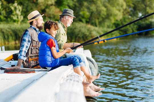 Men of three generations fishing all together