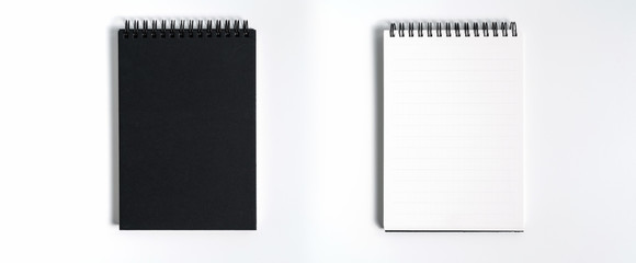 Notebook mock up with clean black blank for design and advertising. Notepad with chromed spring and free copy space template. On the gray background. Wall mural