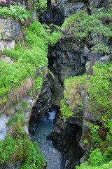 View of deep narrow canyon known as Gouffre des Busserailles in Aosta valley near Breuil-Cervinia, Italy