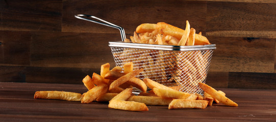 Tasty french fries potato on wooden table background Fotobehang