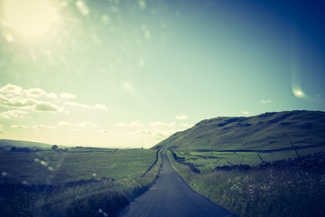 Scotland,  a road in clouded landscape in Summer